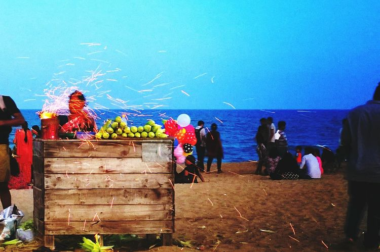Sparks flying from the charcoal grill of a corn seller at Besant Nagar Beach in Chennai. Sparks Fly Chennai Beach Evening Corn Street Vendor Beach Vendor India Sparks Sparks Flying Enjoying The Sunset Feel The Journey Colour Of Life Food Stories Business Stories