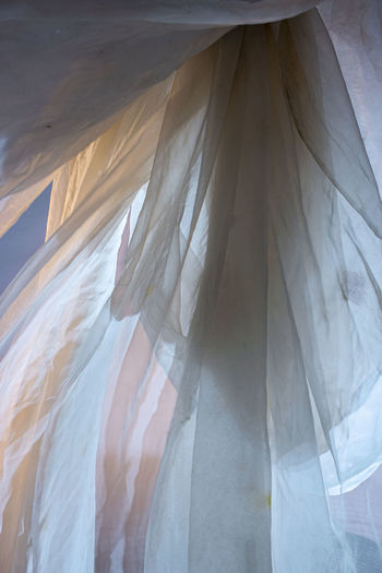 Digital composite image of woman standing in curtain