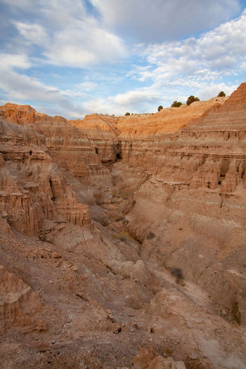 Scenic view of desert canyon against sky