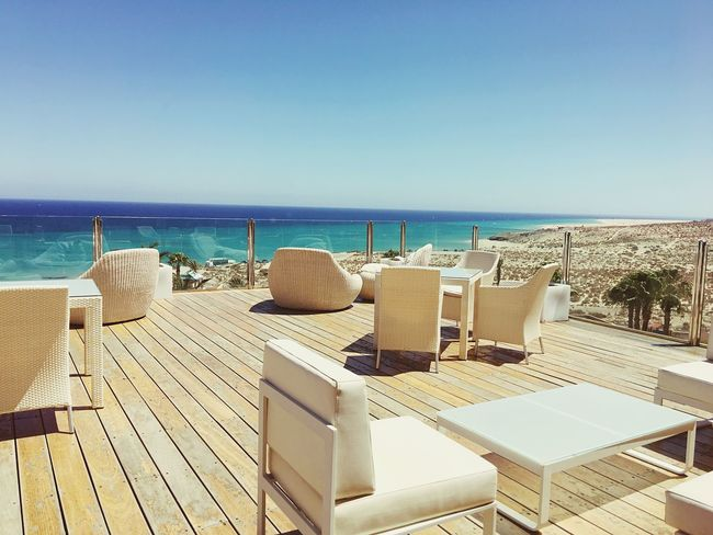 Sea Horizon Over Water Water Beach Chair Clear Sky Nature Outdoors Day Sunlight No People Tranquility Scenics Beauty In Nature Tranquil Scene Vacations Sky Sand Blue Club Beachclub Clubbing
