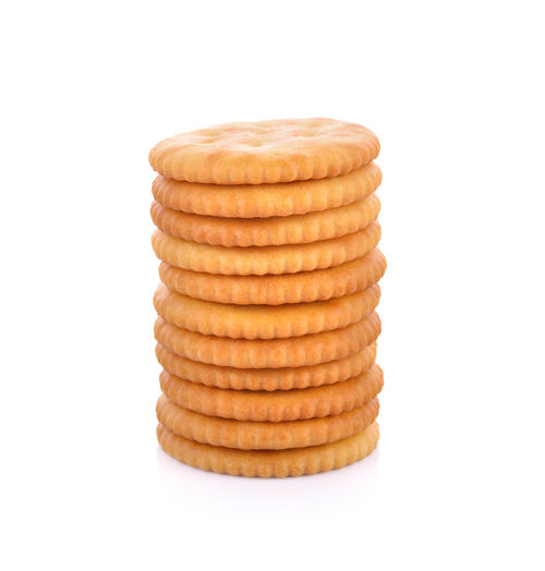 Stack of cookies against white background