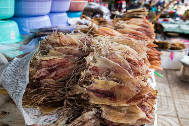 Close-up of dried squid for sale in market