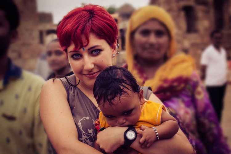 When I was in India, everywhere I went, I was surrounded by people who wanted to take pictures of me or touch me and wanted me to hold their hands and babies because I would bring them fortune. I felt like I was a VIP or a divinity. Beautiful experience. India Incredible India The Tourist People Of India Baby Redhead Travel Travels That's Me Travel Photography
