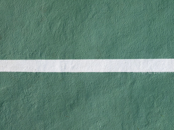 Full frame shot of green wall with white line