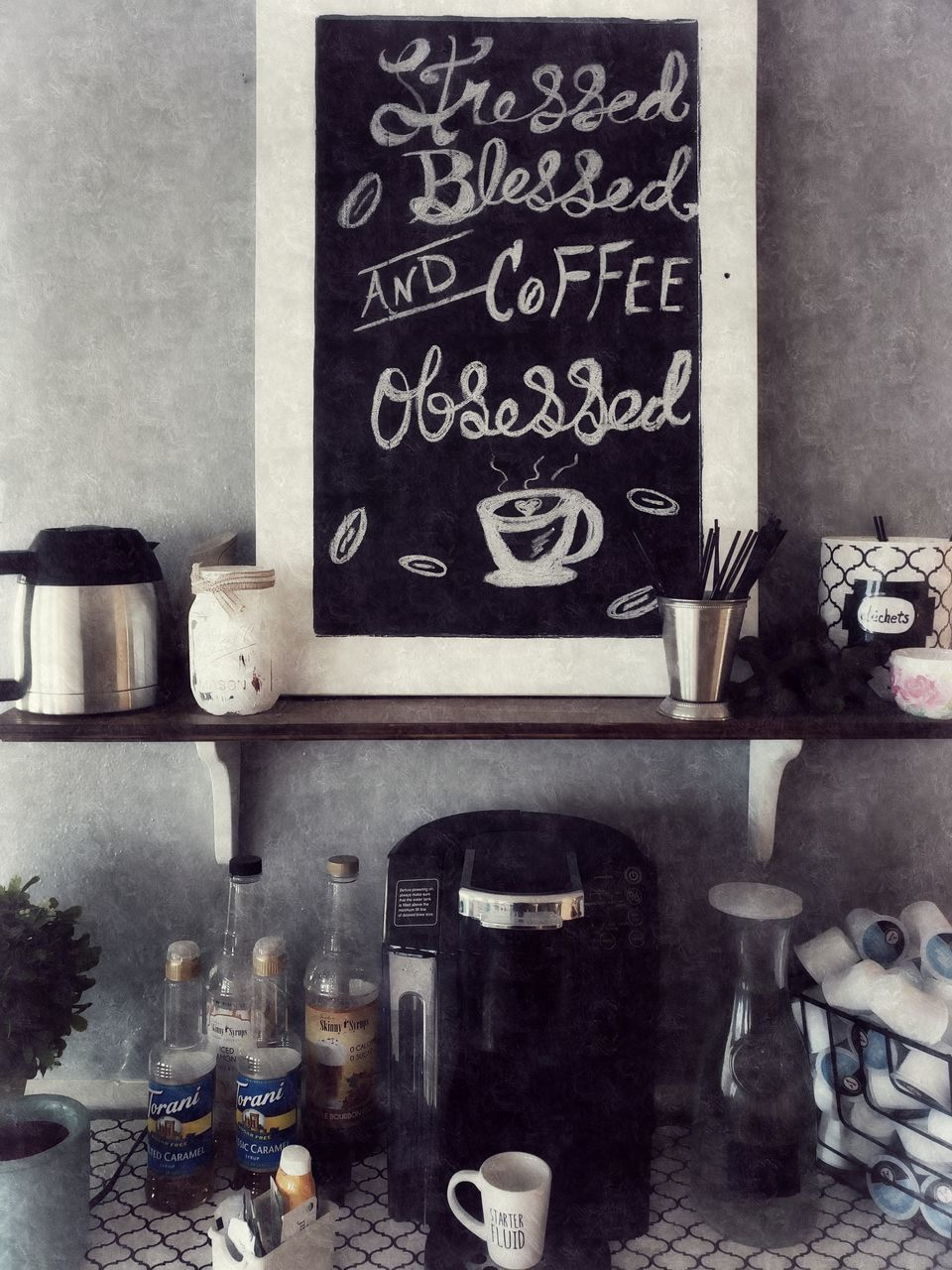 blackboard, board, indoors, shelf, no people, text, domestic room, container, home, communication, western script, bottle, wall - building feature, home interior, table, large group of objects, architecture, day, kitchen, still life, menu, message