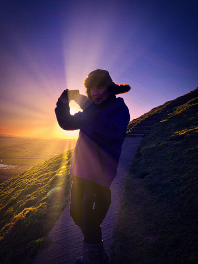 Glastonbury Tor Beauty In Nature Clear Sky Day Full Length Horizon Over Water Landscape Leisure Activity Lifestyles Nature One Person Outdoors People Photographing Photography Themes Real People Scenics Sea Sky Standing Sunlight Sunset Vacations