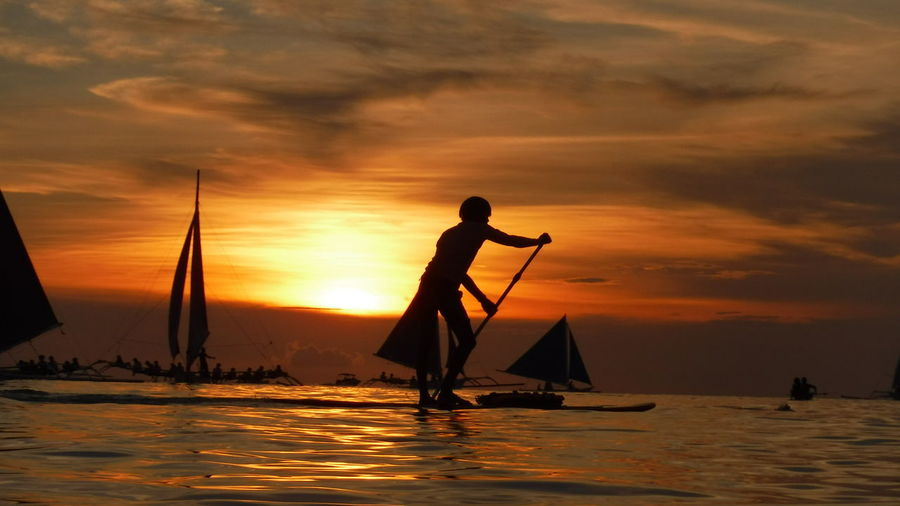 The Week On EyeEm Sunset Silhouette Reflection People Travel Water Silhouette Silhouettes Of People Adventure Sunset Silhouette Sunset Collection Sunset Photography Sunset Bliss The Giant Illusion