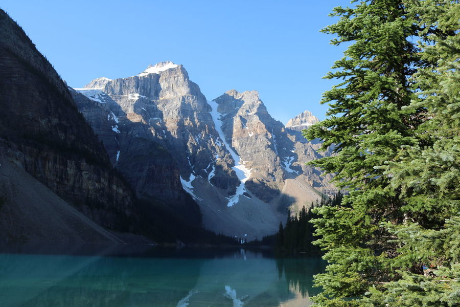 Moraine Lake, AB Beauty In Nature Clear Sky Day Glacial Glacier Global Warming Lake Mountain Mountain Range Nature No People Outdoors Range Reflection Scenery Scenics Sky Snow Tree Water Waterfront