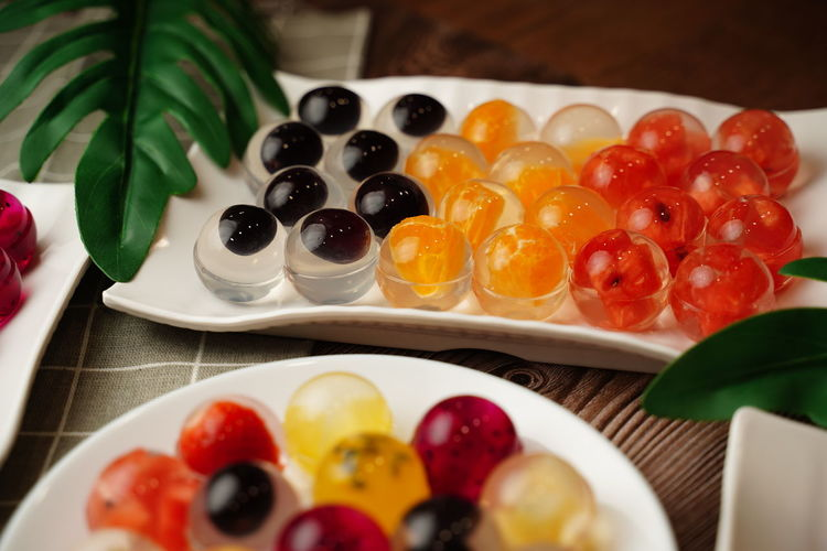Close-up of fruits served in plate on table