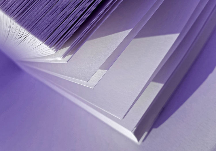 Close-Up Of Blank Papers On Table