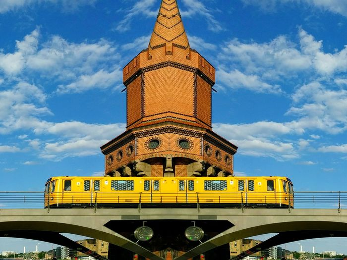 Low Angle View Of Train On Oberbaum Bridge Against Sky In City