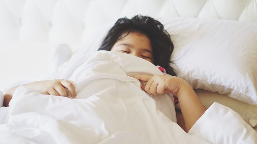 Girl Lying On Bed At Home