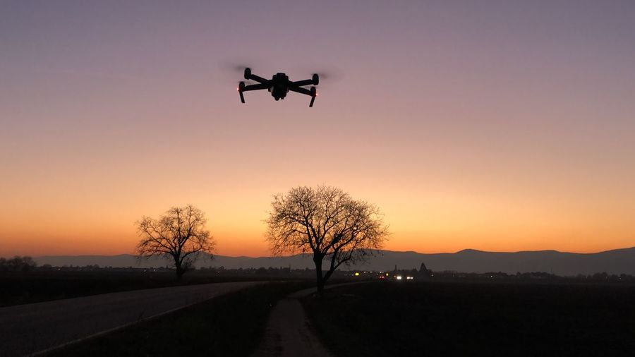 Sunset Sunset Sky Transportation Flying Orange Color Nature Road Air Vehicle Beauty In Nature Outdoors Mode Of Transportation Clear Sky No People Motion Silhouette