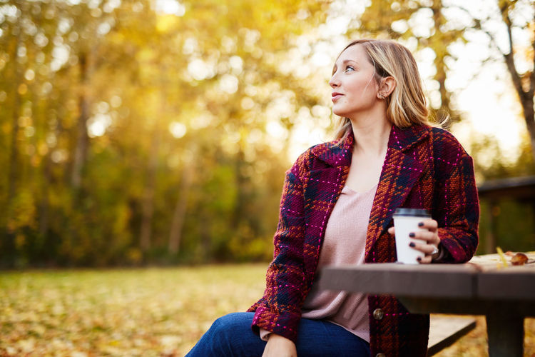 Autumn Beautiful Woman Beauty Blond Hair Coffee - Drink Coffee Cup Day Drinking Focus On Foreground Holding Lifestyles Nature One Person One Woman Only One Young Woman Only Only Women Outdoors Park - Man Made Space Real People Scarf Sitting Tree Women Young Adult Young Women