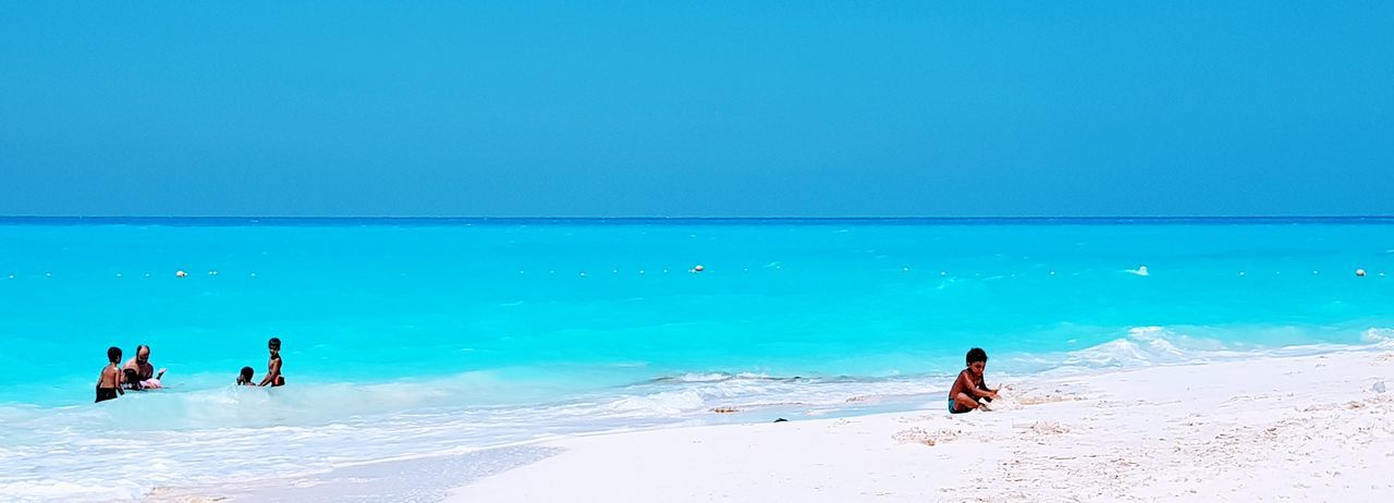 North coast, Alexandria, Egypt Full Length Water Sea Beach Clear Sky Young Women Blue Sand Women Beauty Seascape Sunbathing Beach Holiday Beach Towel Coast Calm Tan Swimwear Horizon Over Water Swimming Trunks Swimming Cap Bikini Turquoise Colored Bikini Bottom