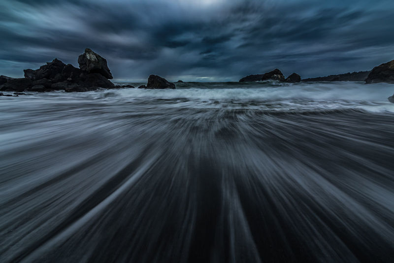 Night at the beach. Trinidad, California. Sky Sea Long Exposure Cloud - Sky Scenics - Nature Motion Beauty In Nature Rock Water Solid Land Rock - Object Tranquility Nature No People Beach Tranquil Scene Blurred Motion Dusk Power In Nature