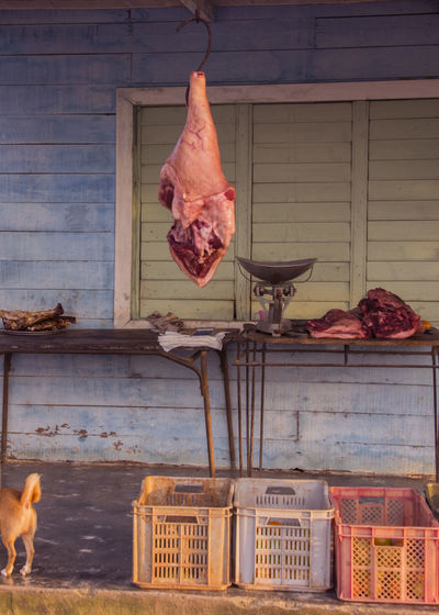 Meat Hanging At Butcher Shop