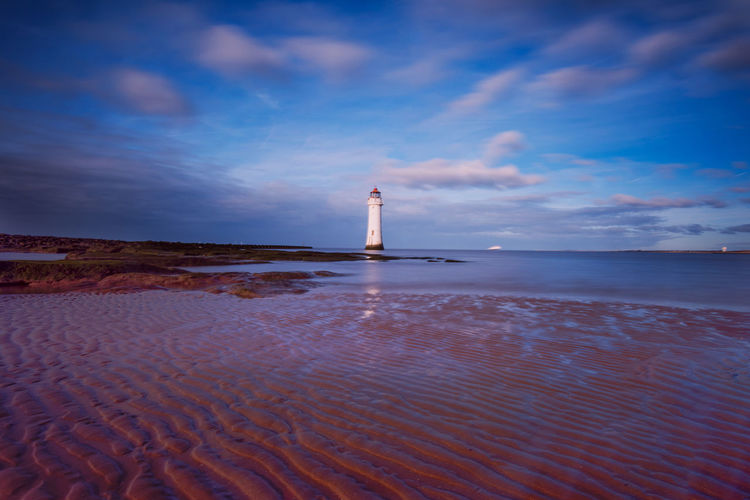 Lighthouse By Sea Against Sky New Brighton Lighthouse Architecture Beach Beauty In Nature Building Exterior Built Structure Cloud - Sky Direction Guidance Horizon Horizon Over Water Land Lighthouse Nature No People Scenics - Nature Sea Sky Tower Tranquility Water The Great Outdoors - 2018 EyeEm Awards