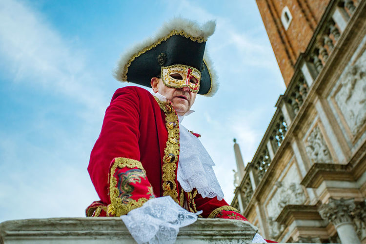 Carnival Carnival In Venice Architecture Building Exterior Built Structure Carnival Costumes Cloud - Sky Day Lifestyles Low Angle View Mask One Person Outdoors People Real People Sky Traditional Clothing Young Adult