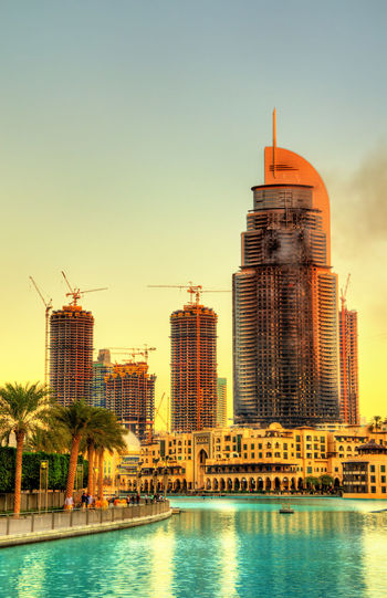 View of buildings in city against clear sky