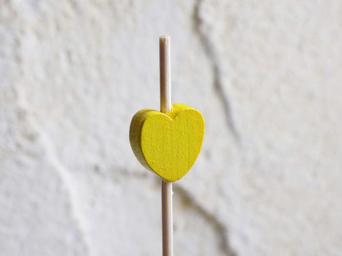 Heart EyeEm Best Shots Taking Photos Taking Pictures Art is Everywhere Yellow Yellow Color EyeEm Selects Knitting Needle Wool Hanging Studio Shot Close-up Heart Shape Needlecraft Product Button Knitting Sewing Clothespin Candy Heart