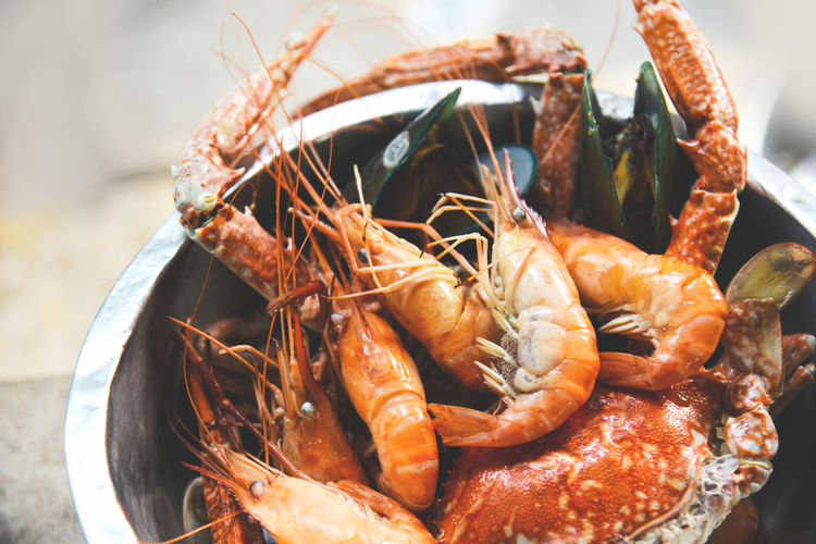 Seafood shellfish with steaming shrimps prawns mussel crab boiled in hot pot Boiled Bowl Catch Clams Closeup Cooked Cooking Crab Crustacean Cuisine Delicious Dish Eat Fish Food Fresh Gourmet Healthy Ingredient Lobster Lunch Luxury Market Meal Menu Mussels Nutrition Octopus Oysters Parsley Peeled Plate Prawn Prawns Prepared Raw Red Restaurant Sauce Sea Seafood Shell SHELLFISH  Shrimp Shrimps Snack Steamed  Tasty White Whole