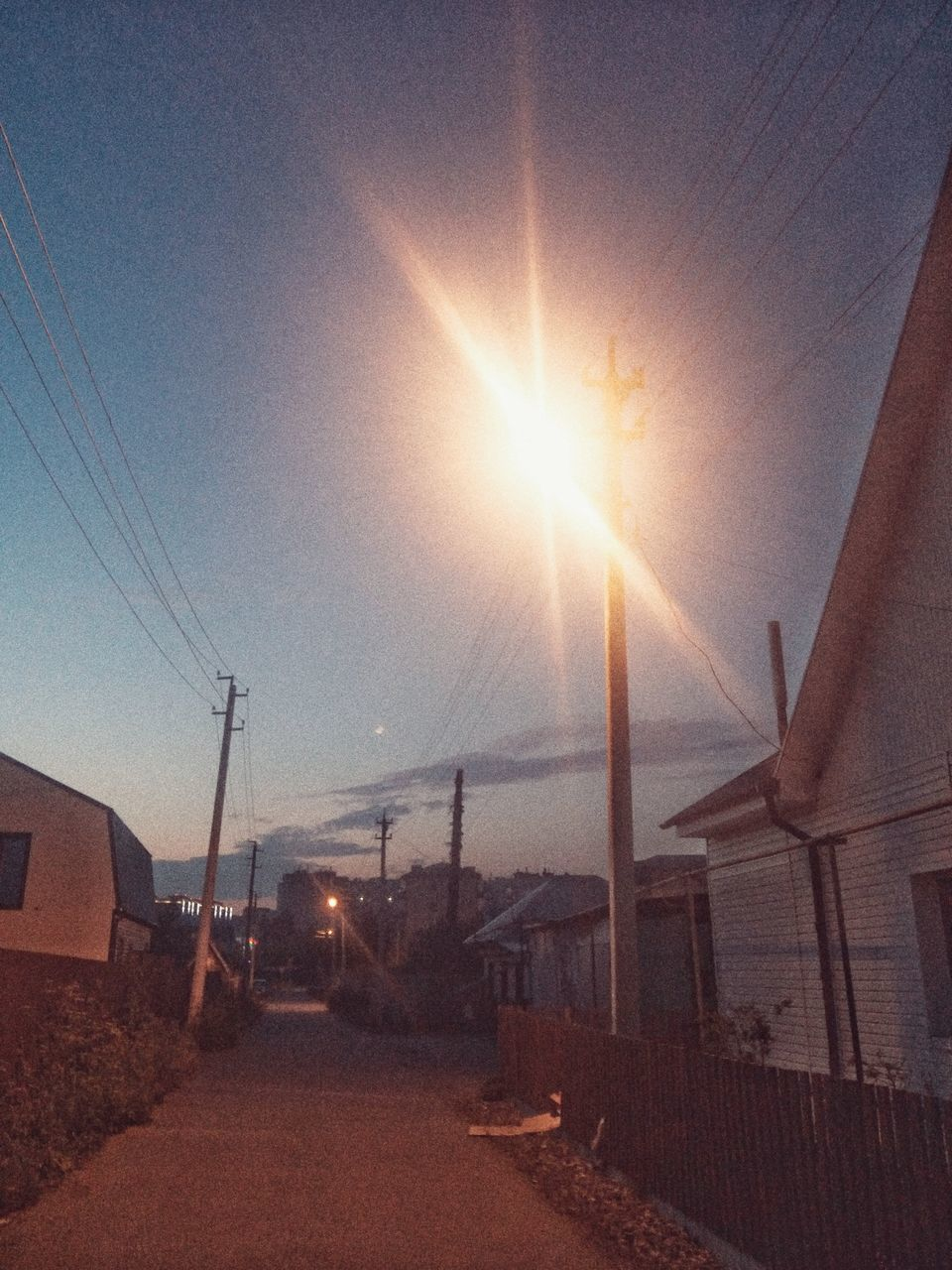sky, sun, sunlight, lens flare, sunbeam, nature, transportation, no people, sunset, architecture, mode of transportation, built structure, outdoors, bright, day, sunny, building exterior, land, road, environment, brightly lit