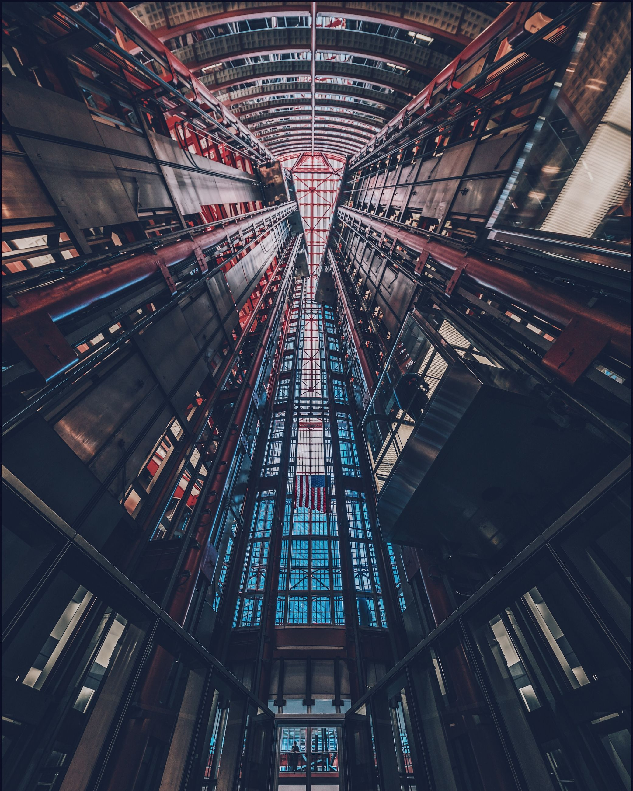 architecture, built structure, low angle view, no people, indoors, modern, building, ceiling, illuminated, tall - high, city, glass - material, pattern, architectural feature, directly below, day, metal, lighting equipment, skyscraper, luxury