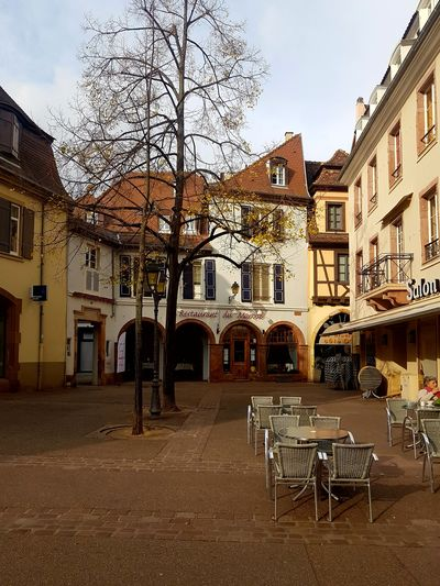 Colmar and a lovely little square Architecture Building Exterior Built Structure Chair Outdoors No People Architecture_collection Historic City Streetphotography Oldbuildings Getting Creative From My Point Of View Getting Inspired Relaxing Moments Atmosphere Taking Photos Lights And Shadows Live For The Story