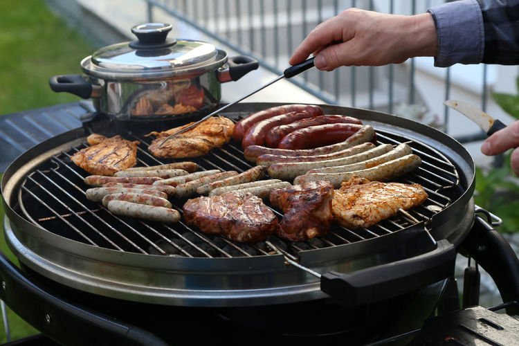 Food And Drink Food Meat Barbecue Freshness Preparation  Human Hand Barbecue Grill Preparing Food Kitchen Utensil One Person Hand Real People Heat - Temperature Human Body Part Grilled Serving Tongs Day Close-up Outdoors Finger Temptation BBQ