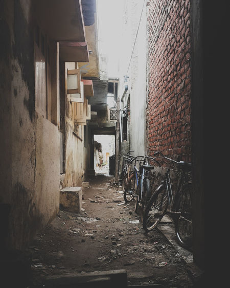 Alley Architecture Bicycle Bicycles Brick Wall Building Exterior Built Structure Day No People Outdoors PhonePhotography Streetphotography