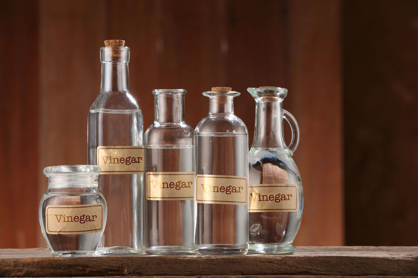 white vinegar on wooden background Container Cooking Food And Drink Liquid Retro Acetic Alcohol Bottle Clear Closed Condiment Food Glass - Material Group Of Objects Healthy Eating Ingredient Label No People Object Organic Transparent Vinegar Water White Vinegar Wooden Background