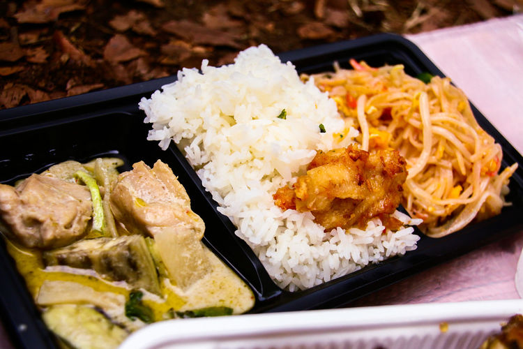 Asian Culture Drinking Ethnic Ethnic Food Festival Food And Drink Freshness Green Curry Ground Healthy Eating Healthy Lifestyle Meal Meat On The Ground Outdoors PLASTIC VESSEL Plate Ready-to-eat Rice Salada Stall Thai Curry Thai Food Vegetables Vietnamese Food Delivery Heroes