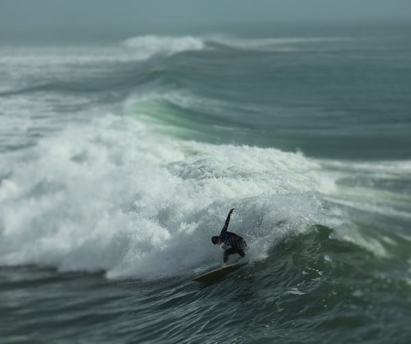 Surfer surfing on waves