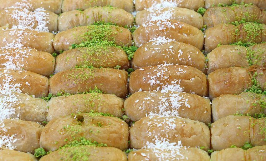 Baklava cookies in retail market display Baked Baklava Close-up Cookies Delight  Dessert Food Food And Drink Food Styling Freshness Full Frame Garnish Gourmet Homemade Indulgence Oriental Pastry Ready-to-eat Serving Size Specialty Sweet Temptation Traditional Turkish Beautifully Organized