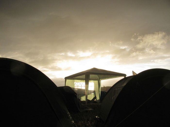 Festival Camping Camping Festival Campsite Campsite View Festival Season Music Festival Festival Moments Pavilion Tent Tents Sun Sunbeam Low Angle View Sunlight Outdoors Cloud - Sky Dramatic Sky Hurricane Hurricane Festival Festival Goer Campinglife Gazebo Campground Pavillion