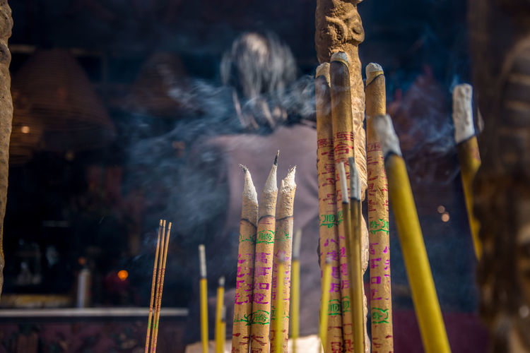 Close-up of incense sticks burning at temple