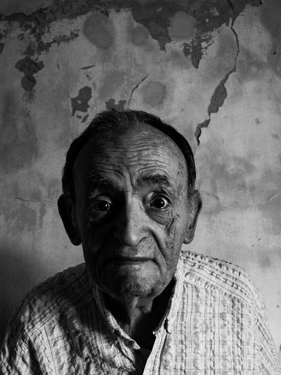 Felipe 76 years, immigrant embarks on Naples Italy after 20 days of travel by boat arrives in Argentina with his family in search of a better future, railway worker, showing his old bike with which he went to work Black & White Close-up Day Decadence Documentary Photography Focus On Foreground Granfather Immigrant Inmigrantes Italian Old Oldman People Photography Photodocumentary Photojournalism Portrait Texture Vertical Years