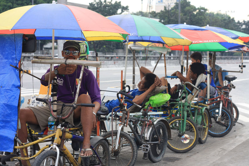 waiting for passengers All In A Day's Work Bicycle Big Umbrella Composition Documentary Photography Driver JournalismPhotography Mode Of Transport Occupation Philippine Transportatio Real People Rest Transportation Tricycle Umbrella Waiting The Street Photographer - 2017 EyeEm Awards BYOPaper!