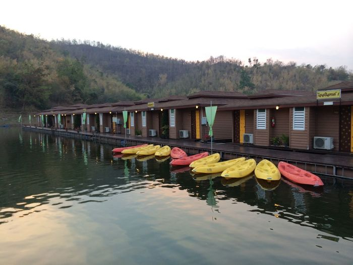 Canoe Kanchanaburi Travel Photography Beauty In Nature Boat Built Structure Bungalow Bungalow On The Water Clear Sky Dam Day Mountain Nature Outdoors Resort Sky Travel Destinations Tree Vacation Water