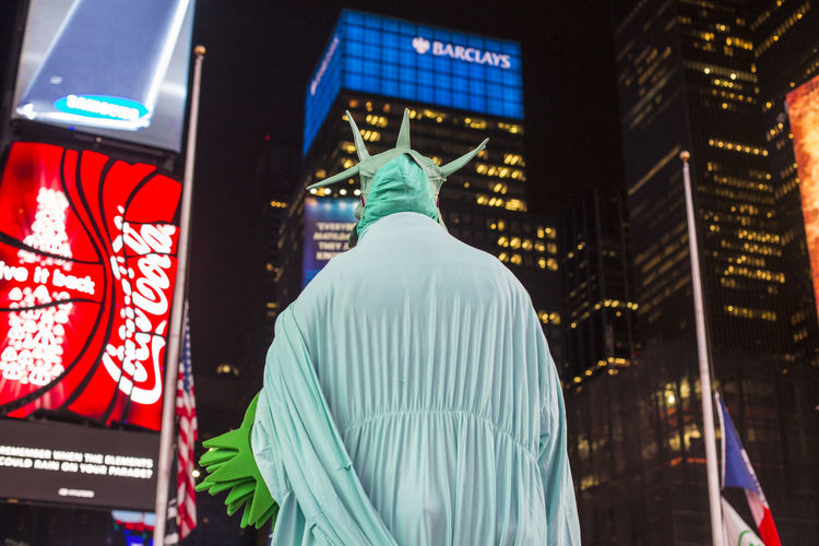 Built Structure Casual Clothing City Costume Liberty Statue Liberty Statue Guy Lifestyles New York New York City Night Time Square, New York Times Square NYC TimesSquare Urban