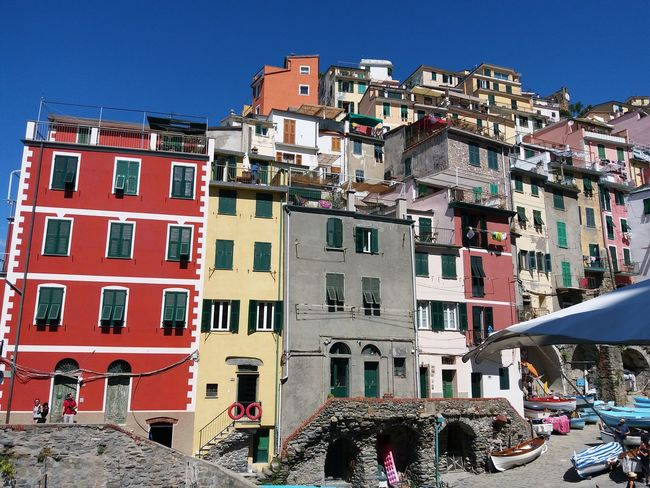 Riomaggiore, Italy, Architecture, Sea, Town, Beach, Brick, View, Harbor, Clothes, Sun, Window, Blue, Square, Mediterranean, House, Terrace, Europe, Italian, Colorful, Vacation, Wave, Cloud, Shutters,village, Coast, Wall, Tourism, Beautiful, Holiday, Trave Chinqueterre Italy Italiansummer EyeEm Selects City Cityscape Photograph Community Low Residential Building Business Finance And Industry Apartment Architecture Sky