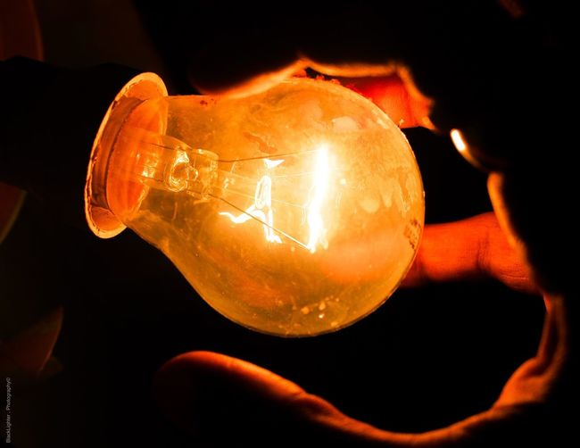 Blacklighter💡 Illuminated Light Bulb Lighting Equipment Orange Color Holding Close-up Electricity  Human Hand Dark Night Focus On Foreground Bulb Glowing Hand Glass - Material