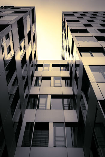 Architecture Architecture_collection Apartment Architectural Column Architecture Building Building Exterior Built Structure City Day Directly Below Glass - Material Low Angle View Modern Nature No People Office Office Building Exterior Outdoors Pattern Reflection Sky Skyscraper Sunset Sunset #sun #clouds #skylovers #sky #nature #beautifulinnature #naturalbeauty #photography #landscape Sunsetarchitecture Sunsetaroundtheworld Tall - High Window