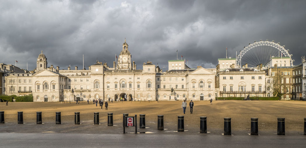 Buildings in city against cloudy sky in london