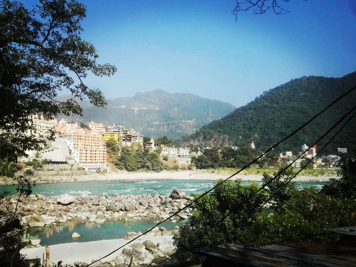 Tree Water Mountain Nature Day Sky Outdoors Lake Clear Sky Beauty In Nature People Rishikesh Ganges River Landscape Spirituality Beauty In Nature GangeRiver Rishikesh_diaries Rishikesh. Travel Destinations Vacations Photographing Photography Themes India