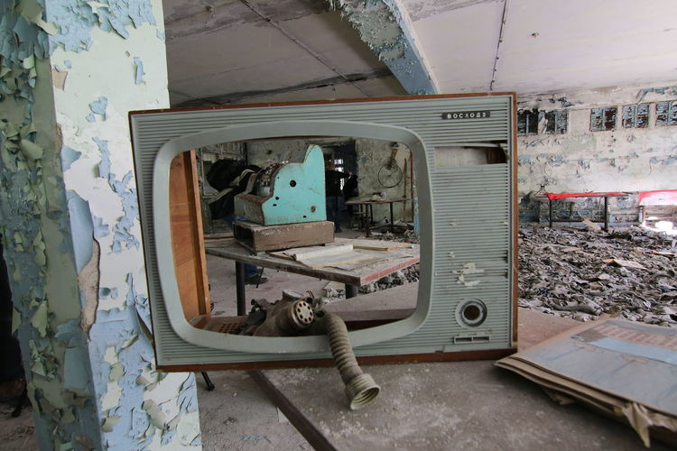 Television Set On Table In Abandoned Building