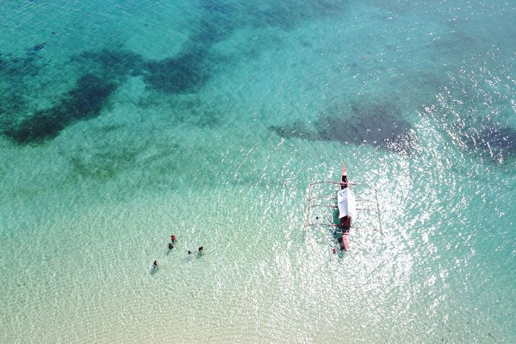 High Angle View Of People Standing In Sea