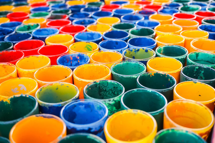 Full frame shot of colorful paint cans