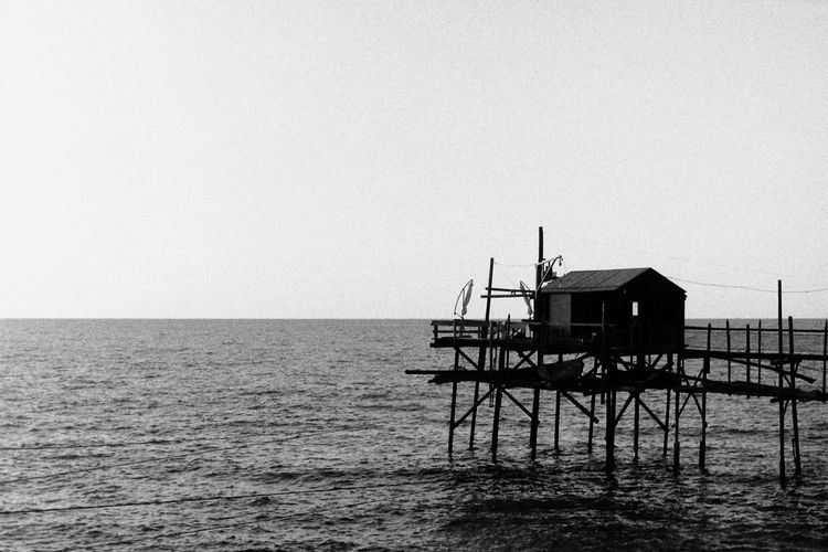 Sea Horizon Over Water Water Built Structure Tranquility Architecture Nature Clear Sky Sky No People Film Photography Seaside No Edits No Filters Trabucco Summer Analogue Photography Wanderlust Black And White Ilford Film Wooden Structure Mediterranean  Italy Termoli  Building Exterior Molise PS: my picture #700 🙂📷🎞